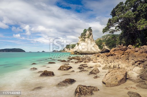 Coast of New Zealand, Cathedral Cove in the coromandel. long exposure of the coastline on a sunny day.
