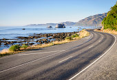 State Highway 1 winding along the eastern coastline of New Zealand's South Island, near the town of Kaikoura.