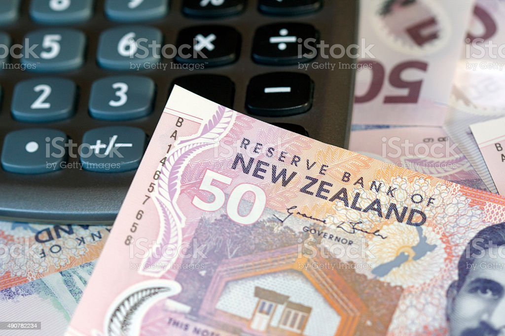 New Zealand Currency and Calculator stock photo