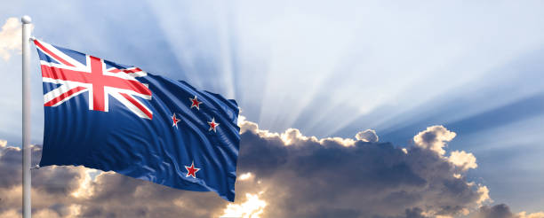 new zealand flag on blue sky. 3d illustration - historic vs new stock photos and pictures