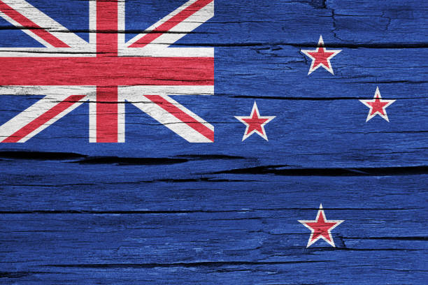 new zealand flag on cracked wood - new zealand flag stock photos and pictures