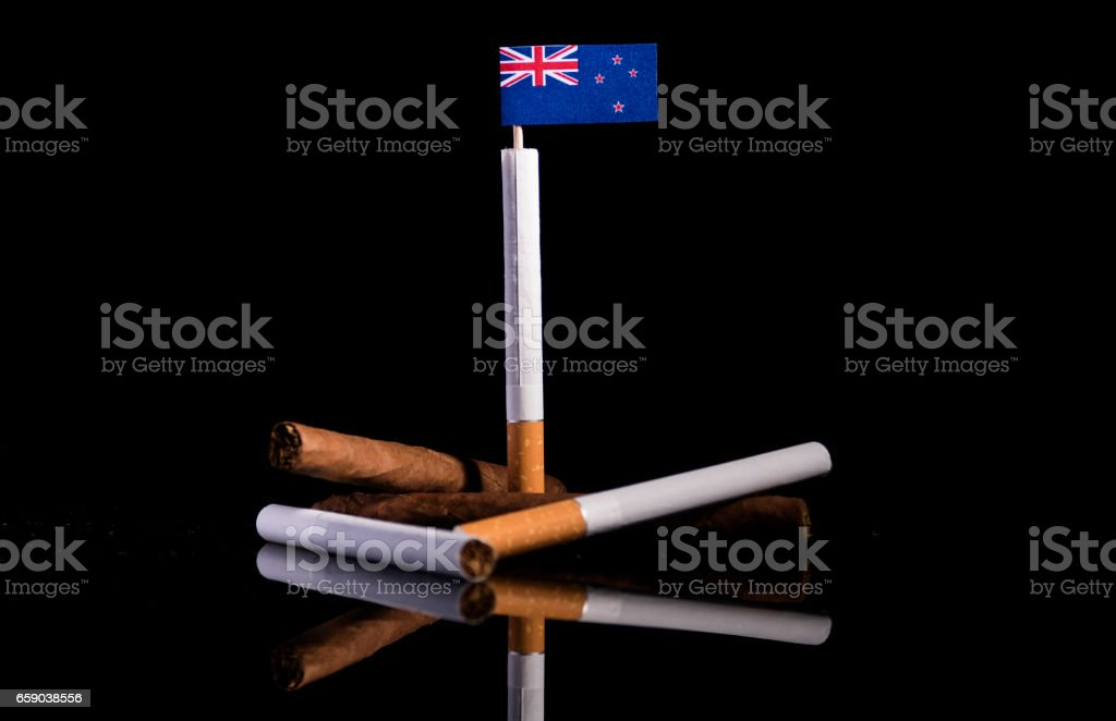 New Zealand flag with cigarettes and cigars. Tobacco Industry concept. royalty-free stock photo