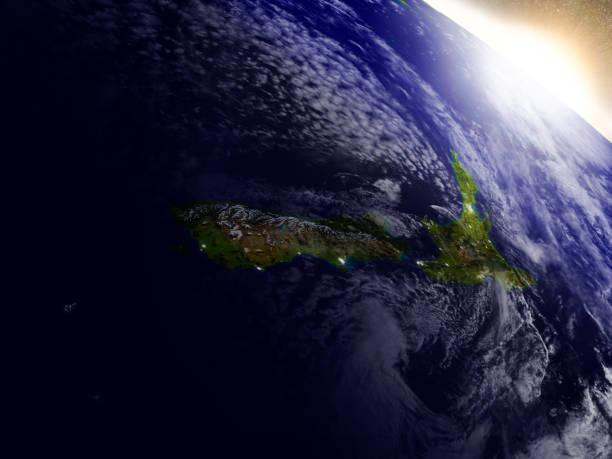 Nueva Zelanda desde el espacio durante el amanecer - foto de stock