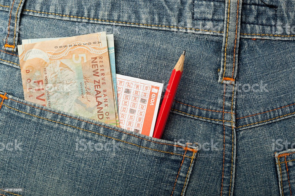 New Zealand money and lottery bet slip in pocket stock photo