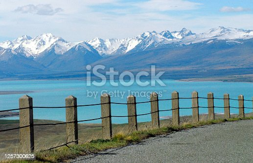 A gorgeous panoramic overview of turquoise Lake Tekapo and the snow capped Southern Alps on the South island of New Zealand.