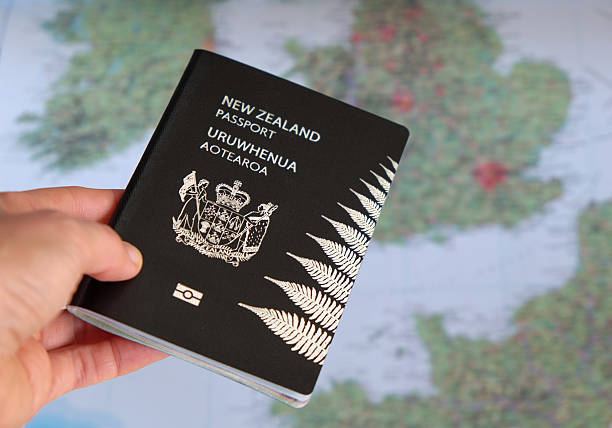 New Zealand passport and Europe map stock photo