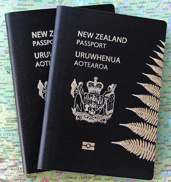 New Zealand passports on a map stock photo