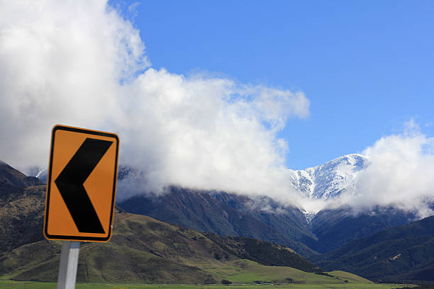 New Zealand Road Sign and Mountains stock photo