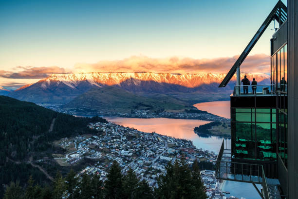 New Zealand travel destination of Queenstown tourist town and remarkables mountain. stock photo