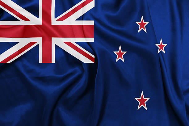 new zealand - waving national flag on silk texture - new zealand flag stock photos and pictures