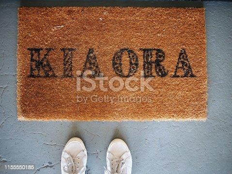Door mat Kia Ora welcome 2 feet white sneakers