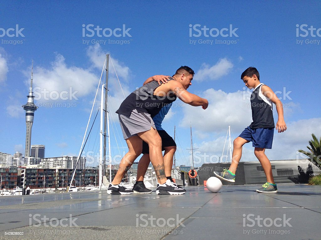 New Zealanders playing touch rugby downtown stock photo