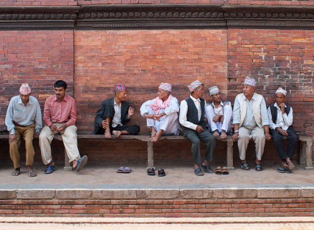 Newar people discussing news at Durbar Square in Patan, Nepal stock photo