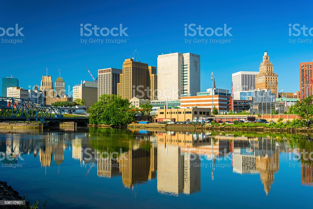Newark downtown skyline and reflection on Passaic River stock photo