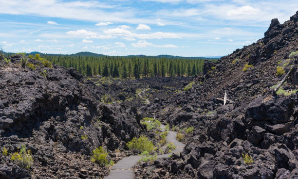 Newberry National Volcanic Monument Lava Butte in Newberry National Volcanic Monument volcanic landscape stock pictures, royalty-free photos & images