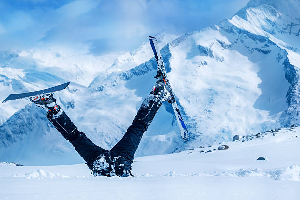 Newbie skier Newbie skier stuck  in deep snow with his legs upside down ski stock pictures, royalty-free photos & images