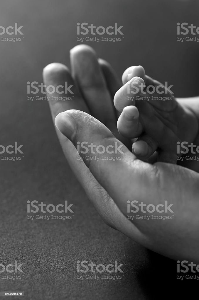 Newborn and his mother hands stock photo