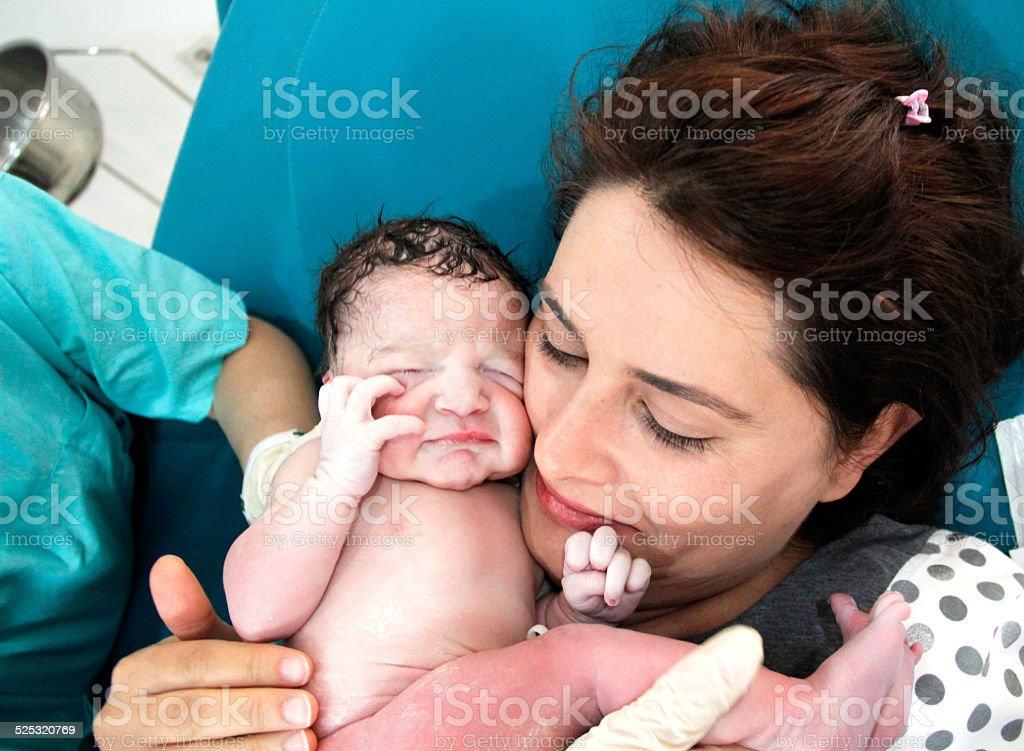Newborn and Mother in hospital stock photo