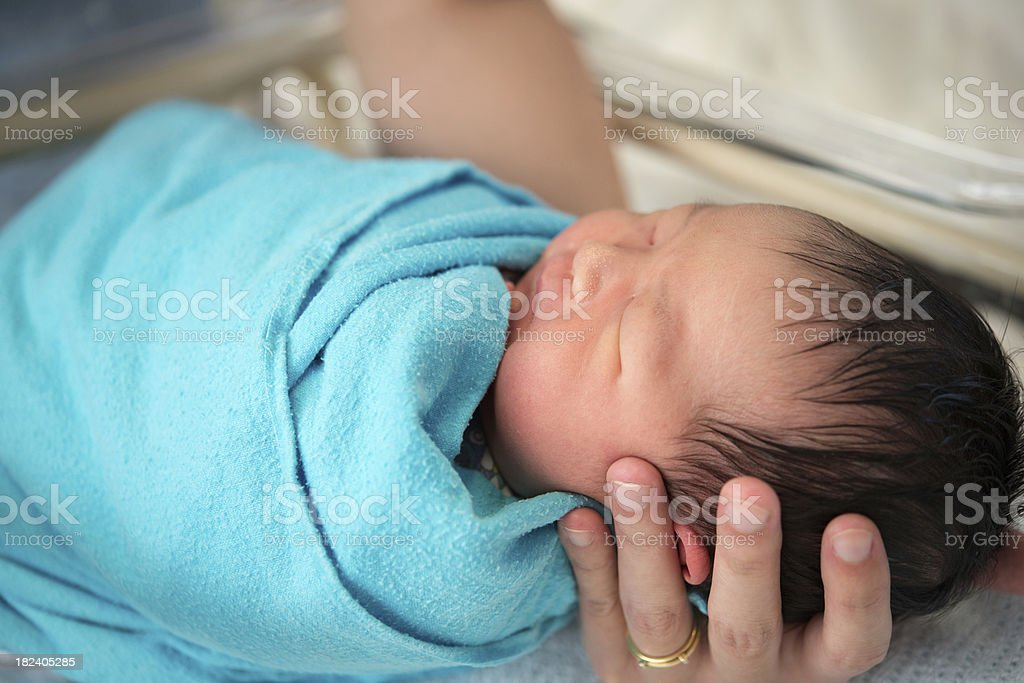 Newborn Asian baby girl in hospital Father holding newborn Asian baby girl, inside hospital room Asian and Indian Ethnicities Stock Photo