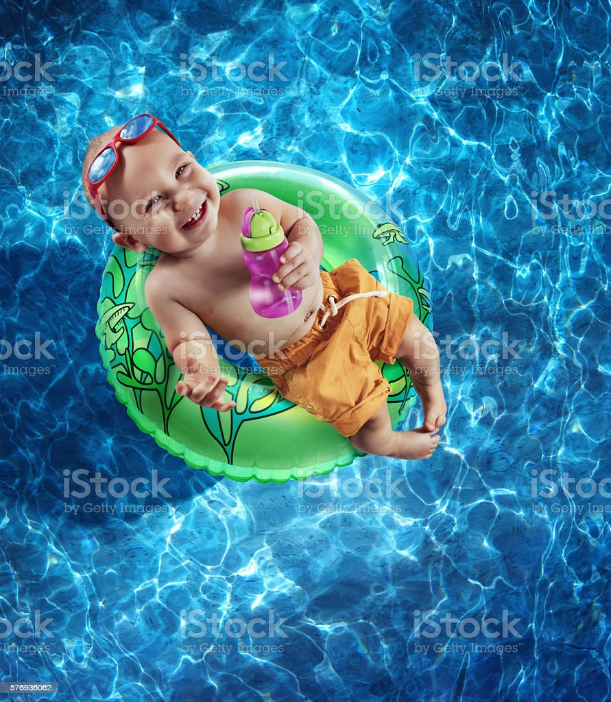 Newborn Baby Boy Floating on an Inner Tube stock photo