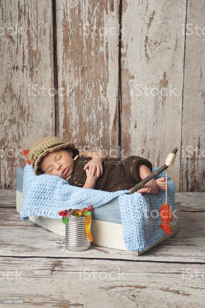 Newborn Baby Boy in Fisherman Outfit stock photo