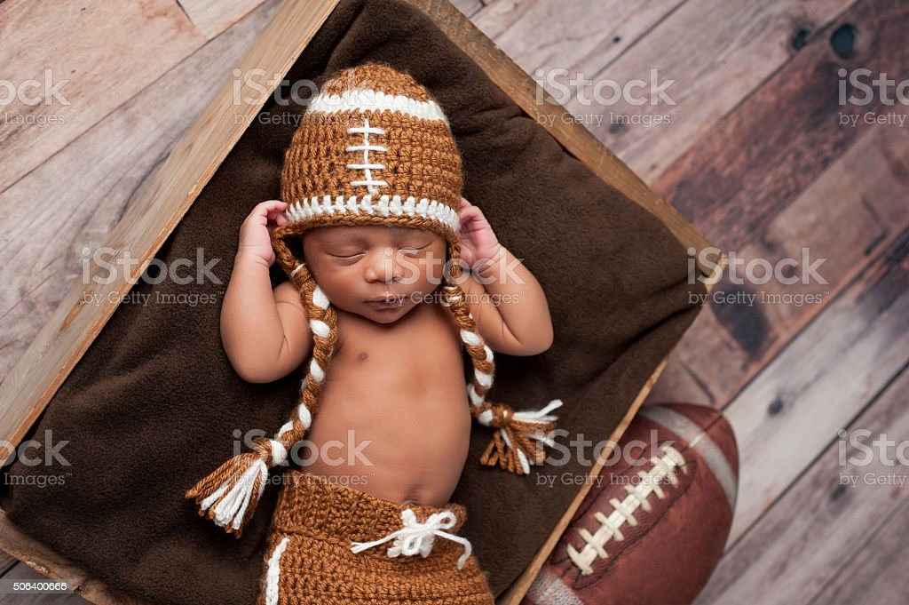 Newborn Baby Boy in Football Costume stock photo