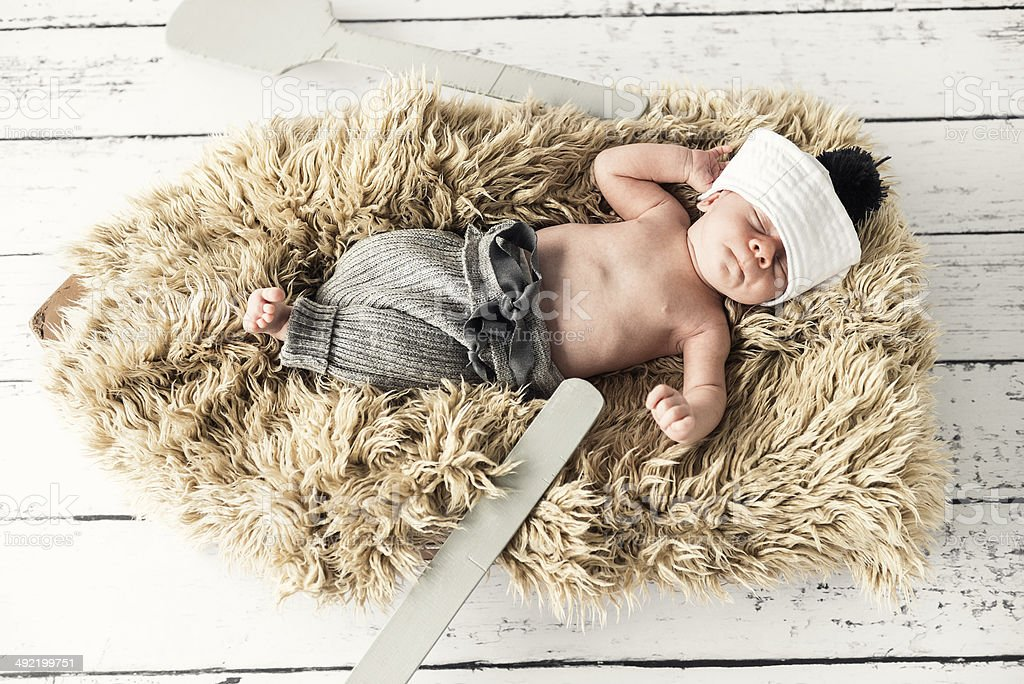 Newborn baby boy is lying on the boat and relaxing stock photo