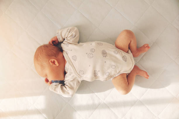 newborn baby boy sleeping in a cot. top view stock photo