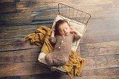 Newborn Baby Boy Sleeping in Little Bed