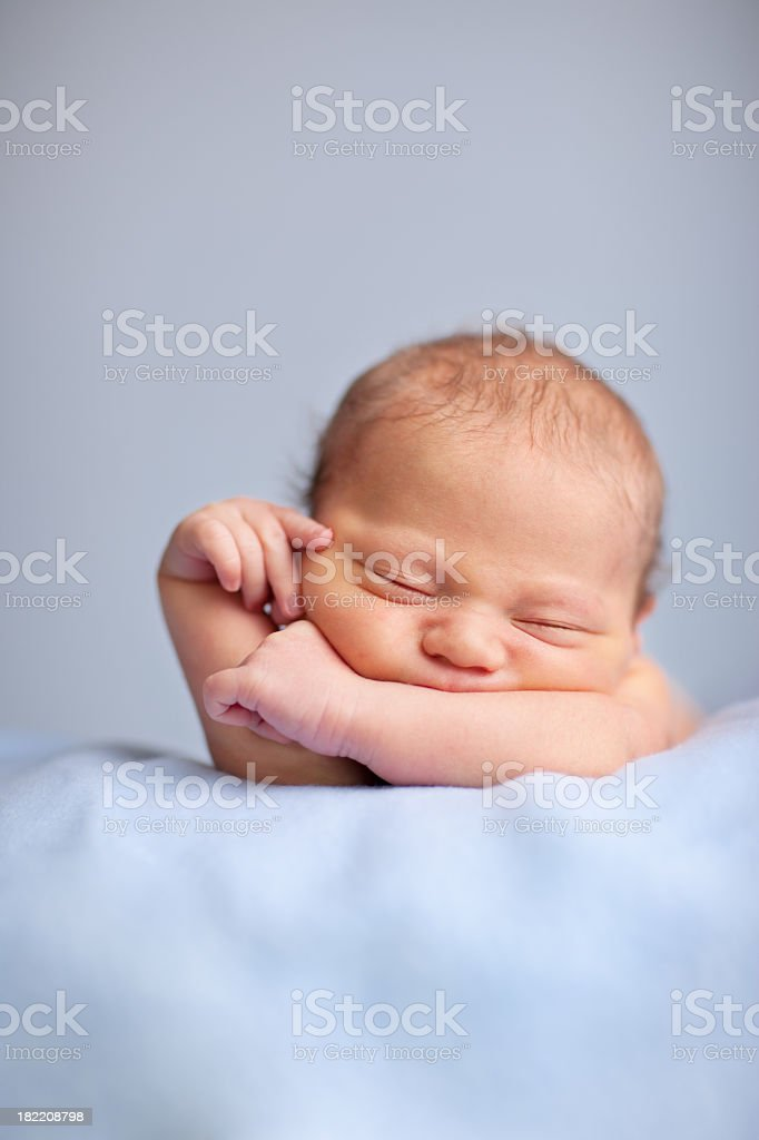 Newborn Baby Boy Sleeping Peacefully on Blue Blanket royalty-free stock photo