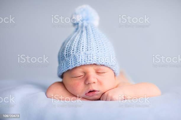 Newborn baby boy sleeping peacefully wearing knit hat picture id109720473?b=1&k=6&m=109720473&s=612x612&h=z etdstu7ojz04l8ifcdywgba1xry5nvonlfz fmmem=