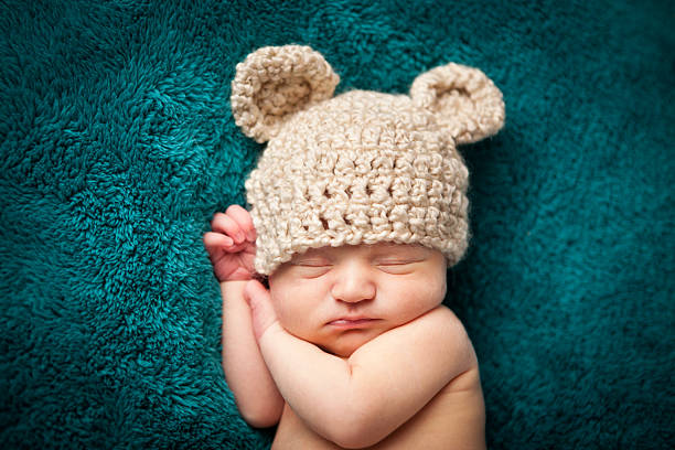 Newborn Baby Boy Sleeping Peacefully Wearing Knit Hat