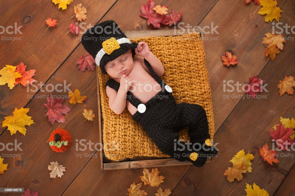 Newborn Baby Boy Wearing a Pilgrim's Costume stock photo