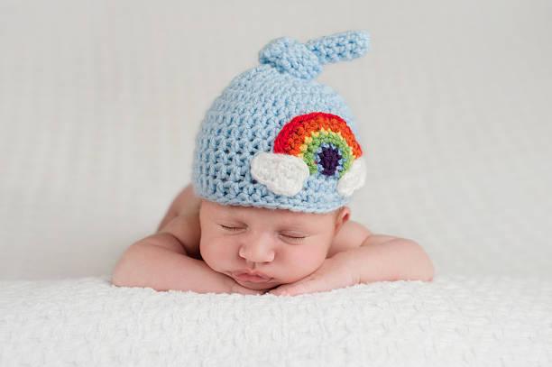 Newborn Baby Boy Wearing a Rainbow Hat stock photo