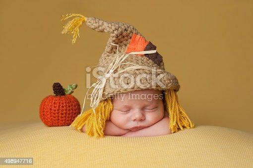 istock Newborn Baby Boy Wearing a Scarecrow Hat 498947716
