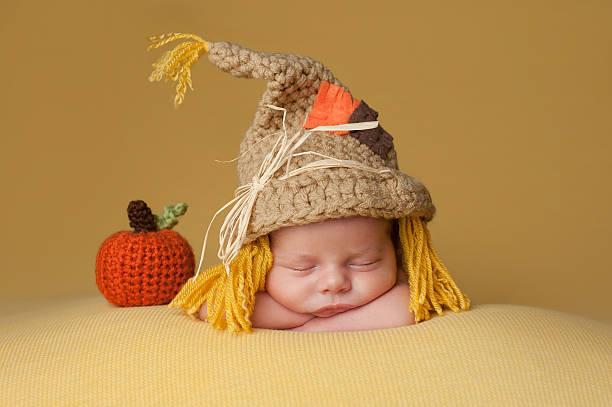 Newborn Baby Boy Wearing a Scarecrow Hat stock photo