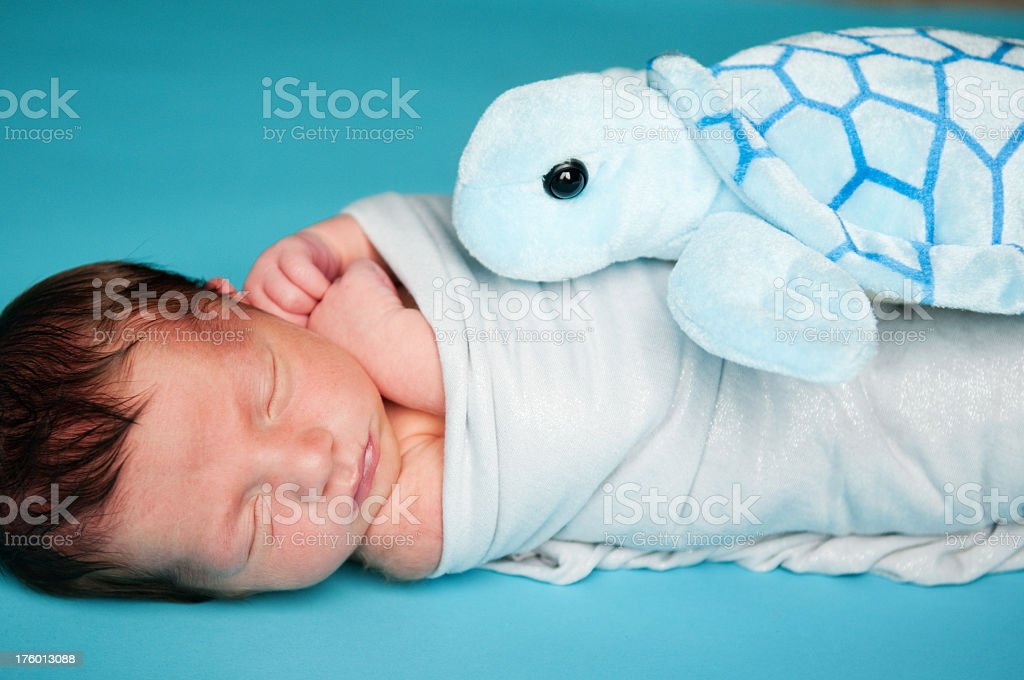 Newborn Baby Boy with Stuffed Turtle stock photo