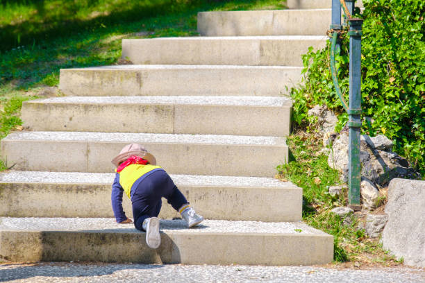 newborn baby climb stairs - first step stock photos and pictures