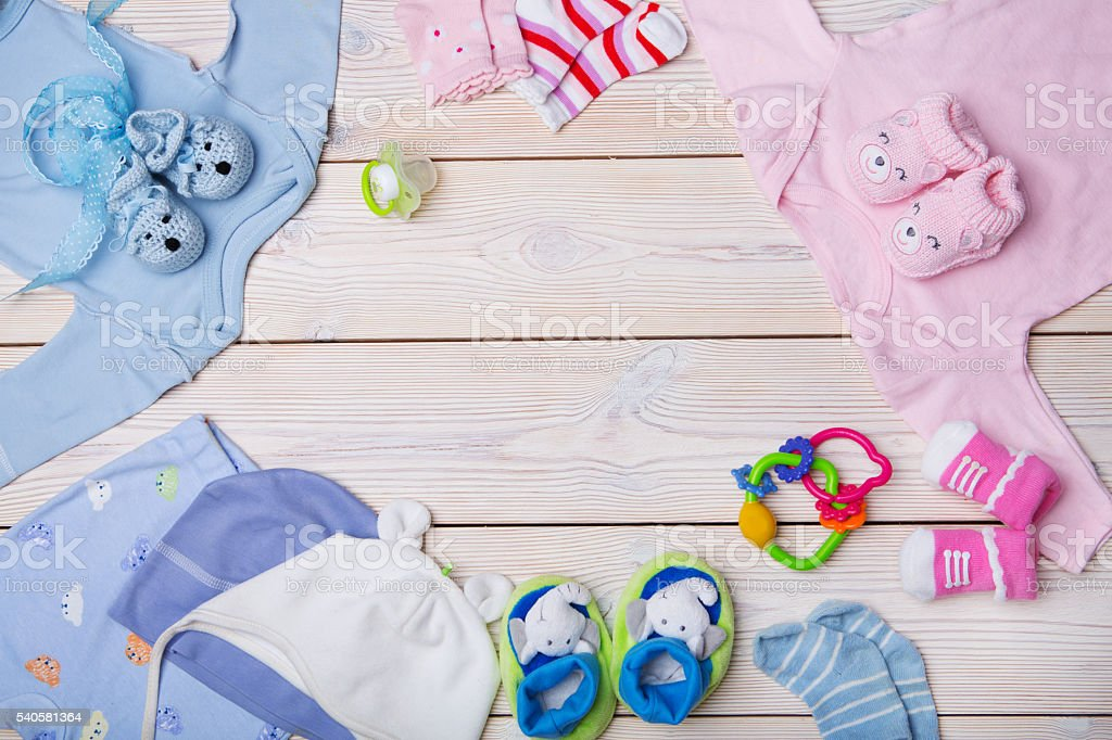 newborn baby clothes stock photo