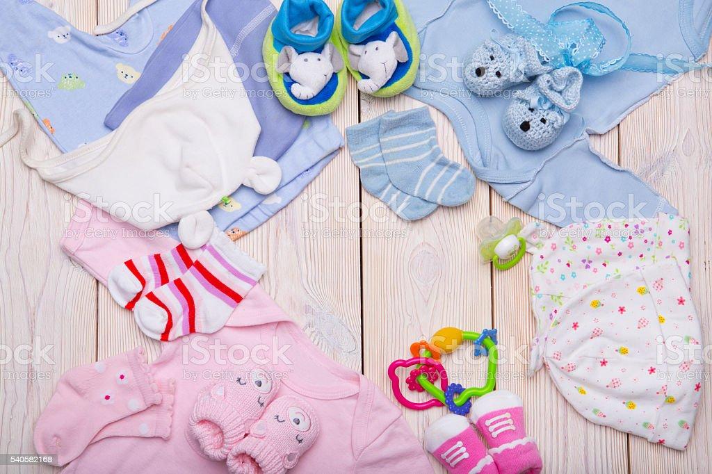 newborn baby clothes stock photo