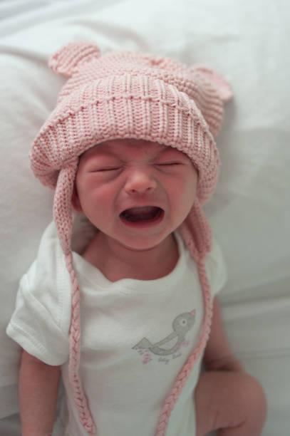 Newborn baby crying at camera stock photo