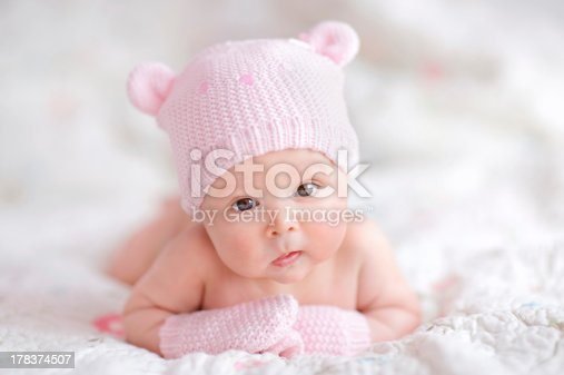 177414958istockphoto newborn baby girl in pink knitted bear hat 178374507