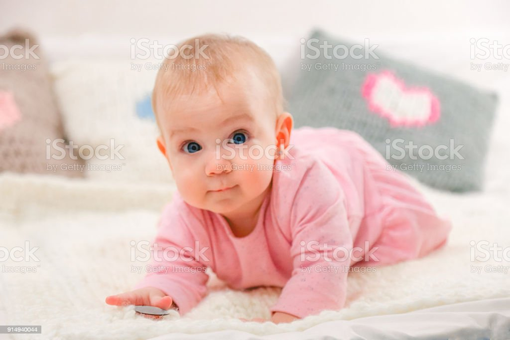 Newborn baby girl in pink stock photo