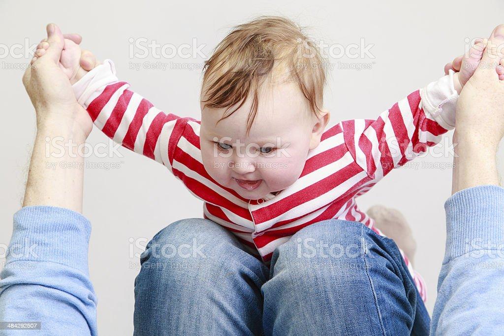 newborn baby girl playing with parent stock photo