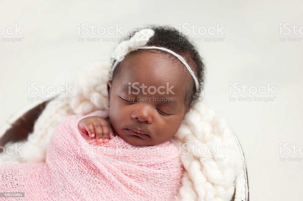 Newborn Baby Girl Sleeping in Bowl stock photo