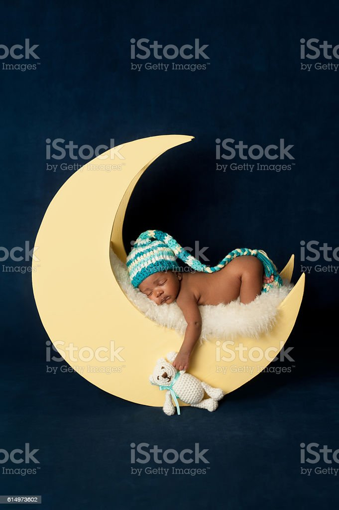 Newborn Baby Girl Sleeping on the Moon stock photo