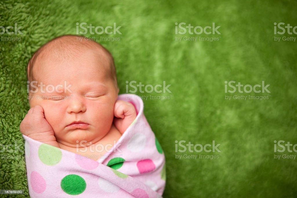 Newborn Baby Girl Sleeping Peacefully in Polka Dot Blanket royalty-free stock photo