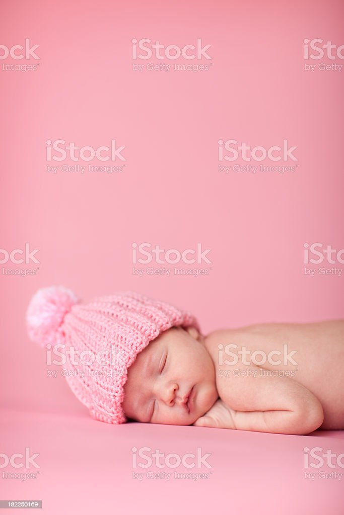 Newborn Baby Girl Sleeping Peacefully on Pink Background royalty-free stock photo