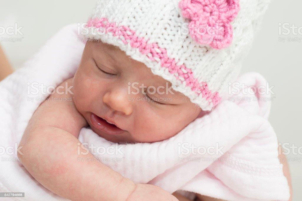 Newborn baby girl sleeping stock photo