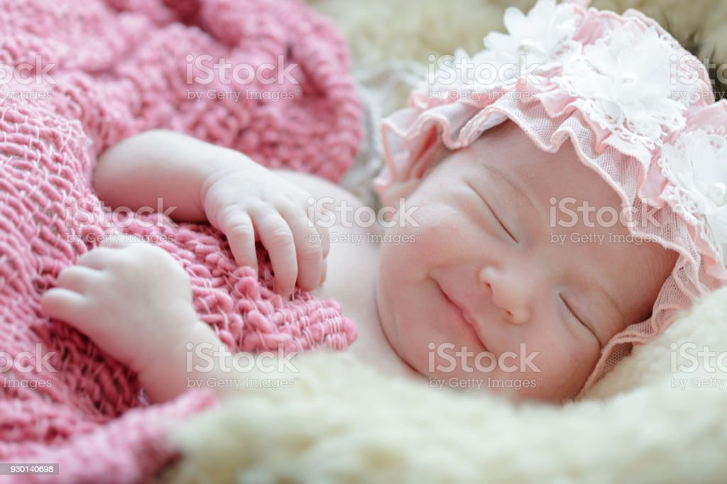 Newborn baby girl smiling in a dream ,Newborn baby girl is sleeping...